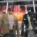 BBC America booth displays the outfits for 1st and 11th Doctors.